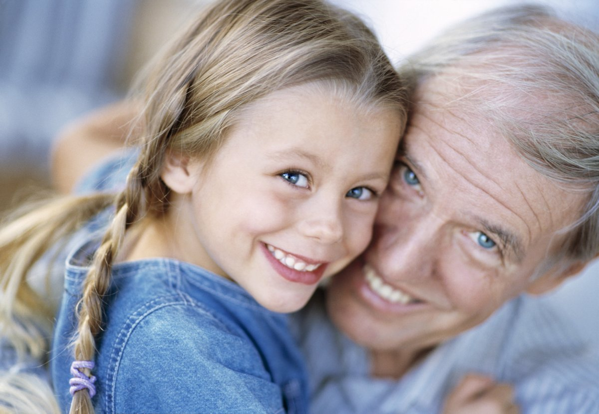 ca. 2003 --- Mature Man Hugging Girl --- Image by © Laureen March/CORBIS